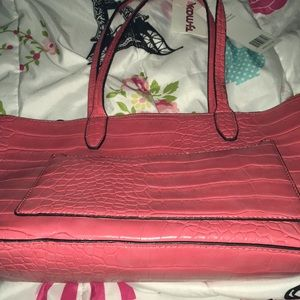 A pink purse from TJ Max Good condition